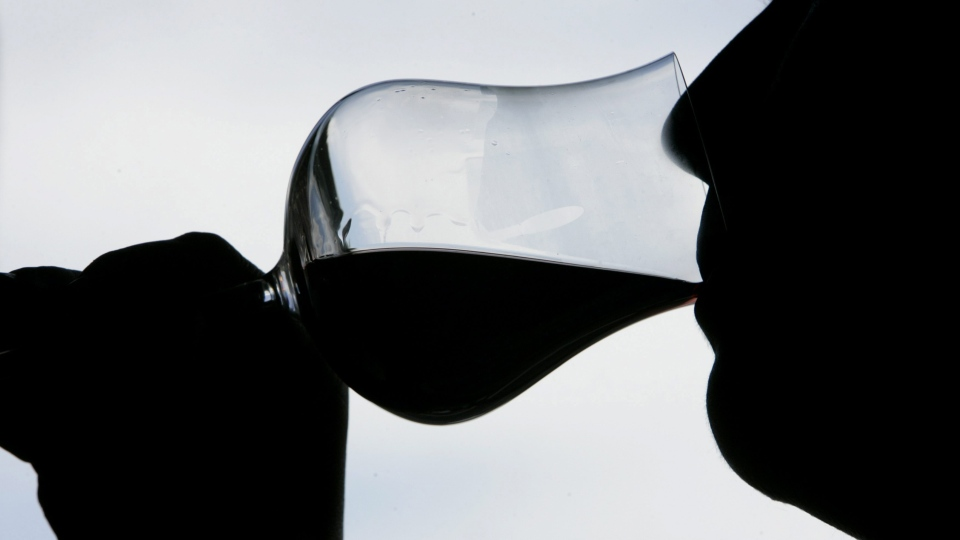 A woman tastes one of southern Italy's full-bodied red wines, near Guagnano, in Puglia. (Pier Paolo Cito / THE CANADIAN PRESS)