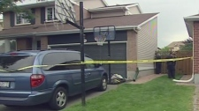 Police block off the backyard of this home after a two-year-old boy drowned during a play date, Wednesday, July 28, 2010.