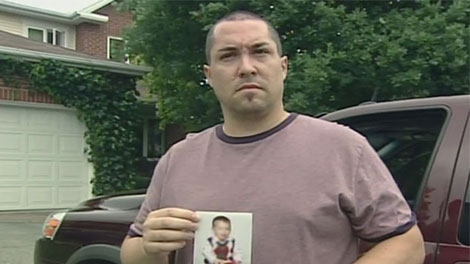 Marc Potvin holds a photo of his nephew after learning of his death. He says his nephew was a happy little boy.