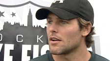 Mike Fisher talks to reporters in Ottawa about his wedding to Carrie Underwood earlier this month.