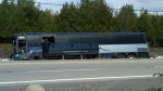 Crews check over an empty Greyhound bus after a fatal head-on crash near Carleton Place Friday, Sept. 7, 2012. (Karen Rocznik/ CTV Winnipeg)