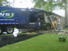 Garbage truck collides into Ottawa home